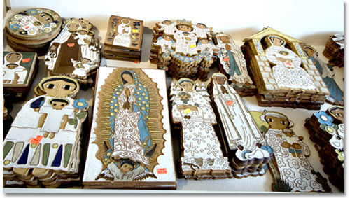 Folk-art style Madonnas are for sale at the abbey ceramics shop.