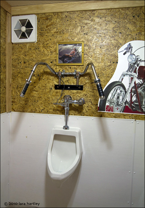 Harley handlebars add an interesting look to the mens bathroom at the Happy Burro Chili and Beer club.