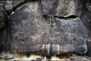 Bighorn sheep are depicted with some similarity to the bighorn petroglyphs in the Coso Range to the northwest.
