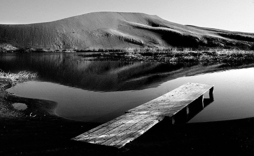 The dock in the pond at the base of Idaho's Bruneau Dunes creates the type of diagonal line we talk about in the column; leading the eye into the image.
