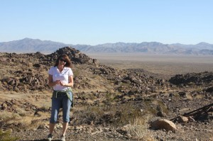 Photo of author on Old Dale Rd.  with a view of the Pinto Basin below.
