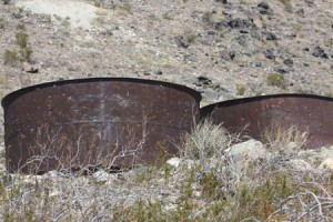 Rusted cyanide vats at old mining site.