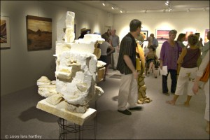 A futuristic sculpture is figured prominently in one of the three galleries in the 29 Palms Gallery and Art Center. Guests at the opening reception mingle and enjoy the various pieces of art.
