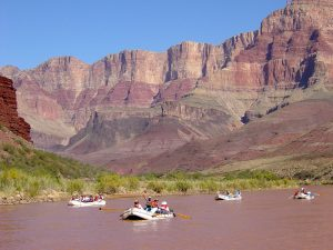 A COMMERCIAL RAFT TRIP ON THE COLORADO RIVER PASSES CARDENAS CREEK IN GRAND CANYON NATIONAL PARK.