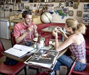 Italian tourists Angelo Massimo Gangi and new wife Erika Genovese sample food from the quintessential Route 66 diner, the Bagdad Cafe in Newberry Springs.