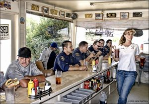 Perky Holland Burger waitress Shawna Gentry rushes soft drinks to customers during a busy lunch hour.