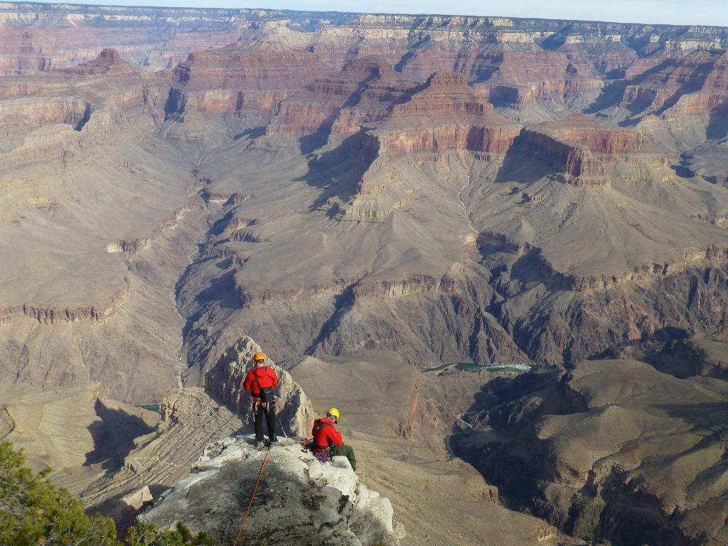 Two rangers stand at the edge of the Grand Canyon during a recovery operation NPS Photo
