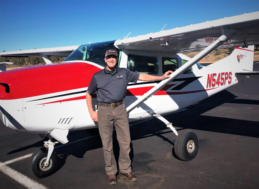 Howell in front of a fixed wing aircraft Williams-Grand Canyon News