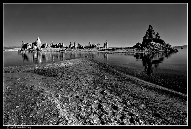 The reflections in the still water of Mono Lake add an extra dimension to this scenic shot. When you have water, look for reflections for your photos. By Lara Hartley