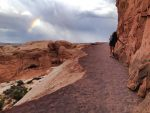 Chasing rainbows at Delicate Arch Trail.