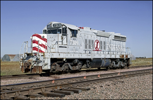 Photo courtesy of Grumpy's World This is an EMD SD-18 locomotive roster shot with reporting marks indicating ownership by the Indiana Boxcar Corporation, and presently in service at the United Farmers Coop in Tamora, NE. It was originally purchased new by the Chesapeake & Ohio Railroad where it was number 1809. This photo was taken on October4,2003.