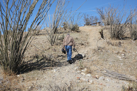 Jim, Publisher of DesertUSA.com, hiking up to tape the view above the Desert Gardens.