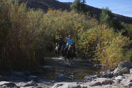 Horseback riders emerging from the third crossing.