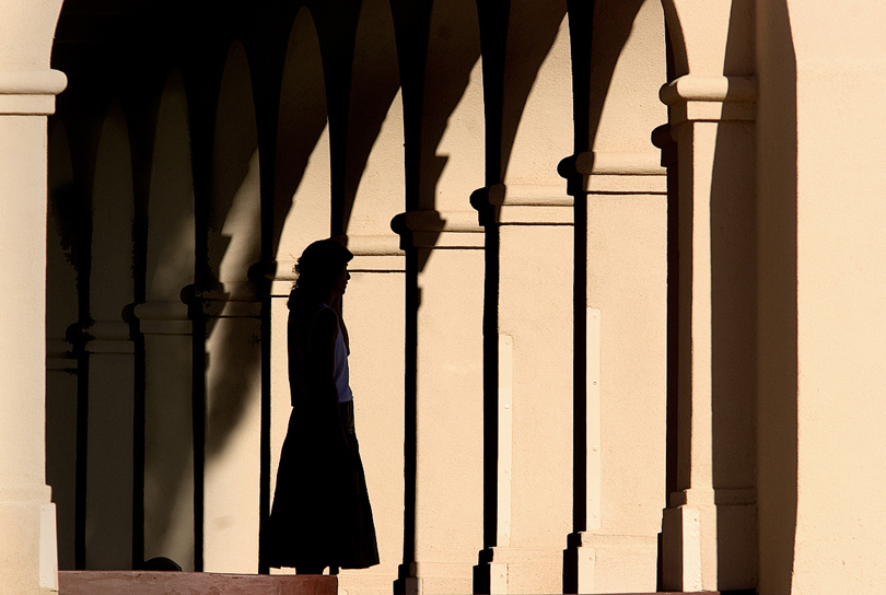 A visitor to the restored Kelso Depot on the Union Pacific line is silhouetted by the afternoon sun as she takes in the ambiance of the depot in the desert.