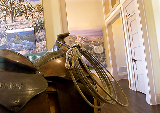 An antique saddle with rope is part of the exhibit paying homage to the history of cattle ranching in the Eastern Mojave.