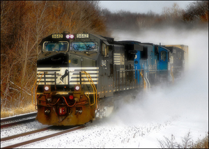 Photo courtesy of A.J. Smith A fast-moving westbound intermodal train, hauling truck trailers from the East Coast to the Midwest, blasts through freshly-fallen snow in Western Pennsylvania. This was photographed with Smith's 70-300mm lens.