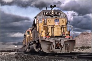 Dramatic clouds and a low angle add some interest to this wedgie shot of a Union Pacific Railway train sitting outside of Nipton, Calif. in the far Eastern Mojave Desert.