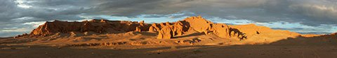 Panorama picture of The Flaming Cliffs, Gobi Desert, Mongolia. Composed from several images taken at sunset on the 8/2/2005 by Zoharby. Licensing GFDL-self. Category:Mongolia, Wikipedia